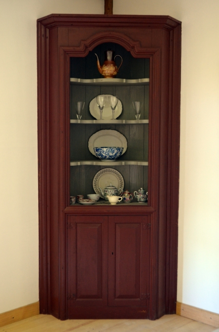 The corner cupboard in the parlor.