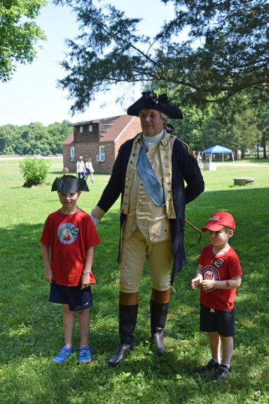 Two young gentlemen meet General George Washington portrayed by Greg Fisher.