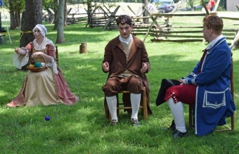 Theater performance showing 18th century courting customs.