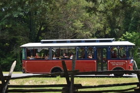 Visitors arrive to Ferry Farm on one of Fredericksburg's iconic trolleys.