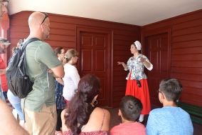 A group begins their tour of the Washington house replica.