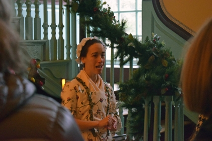 Rachel Sargeant as Lucy Thorton Lewis greets visitors in the Passage.