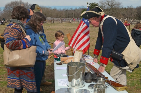 Reenactor Paul Limerick discusses Continental Army rations with visitors.