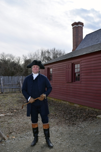 George Washington (Greg Fisher) in front of the Washington house replica.