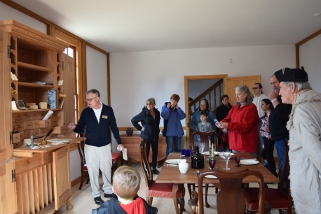 Visitors tour the Hall of the Washington house with interpreter Gary Haynes.