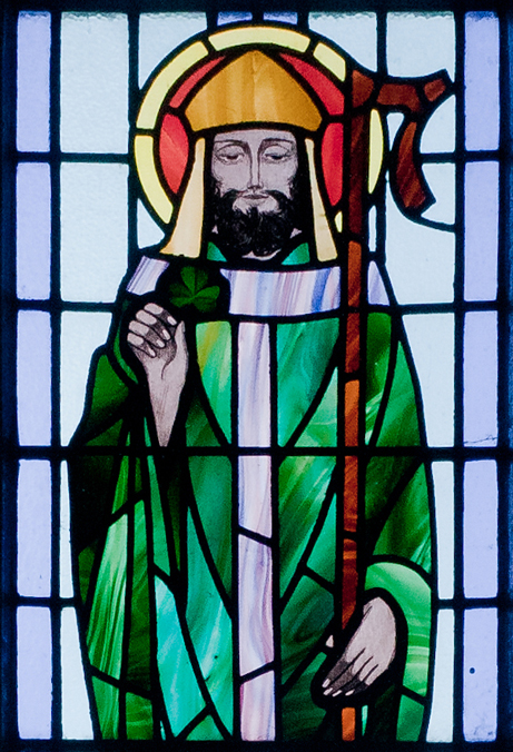Kilbennan's St. Benin's Church window depicting St. Patrick holding a shamrock
